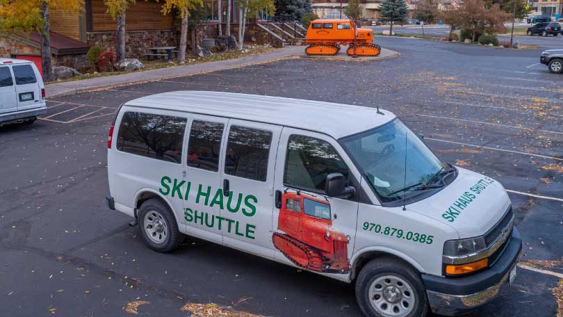 Parking lot view with Ski Haus shuttle van.